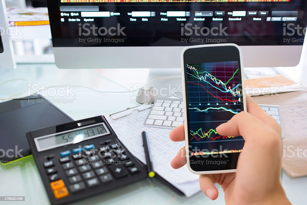 Stock market graph and office work stock photo