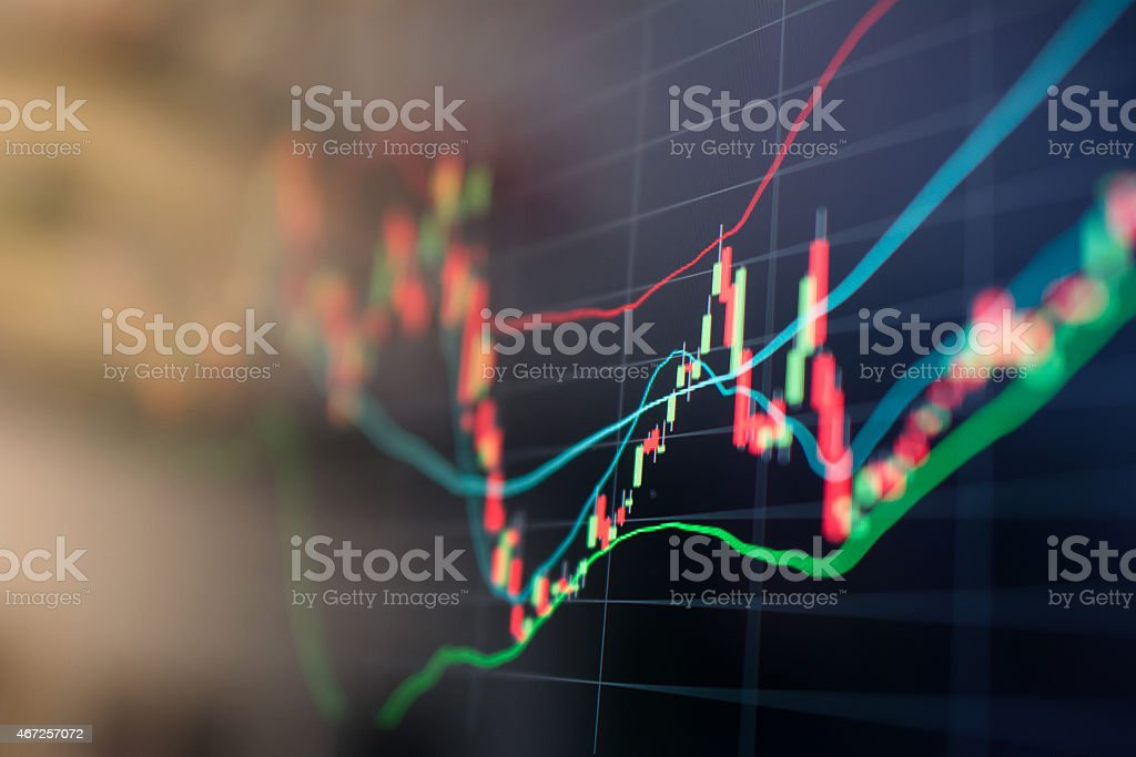 A stock market graph on a black background stock photo