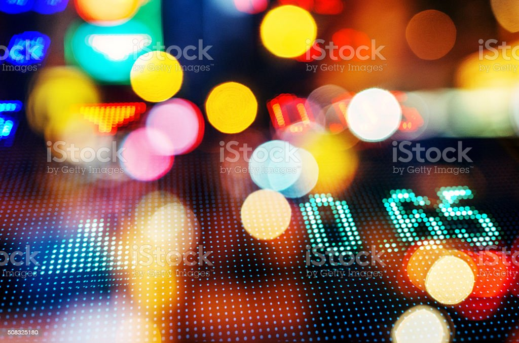 stock market numbers with Blurred city lights stock photo