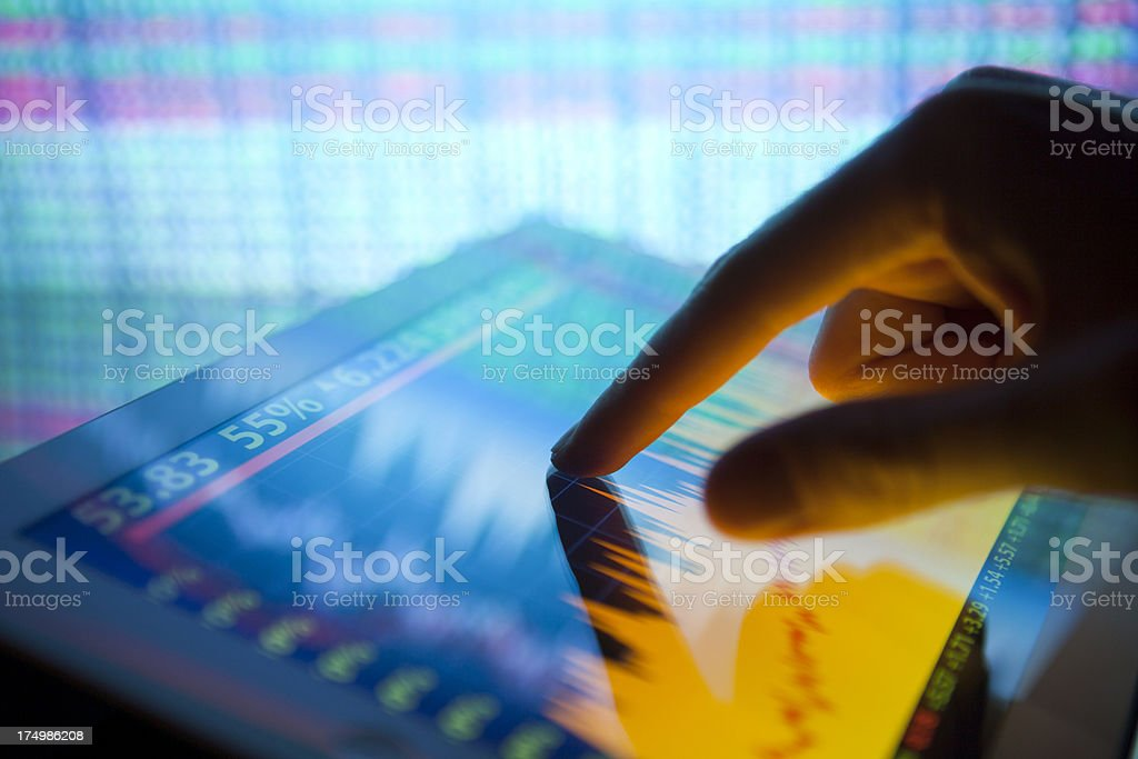 Stock market on digital tablet royalty-free stock photo