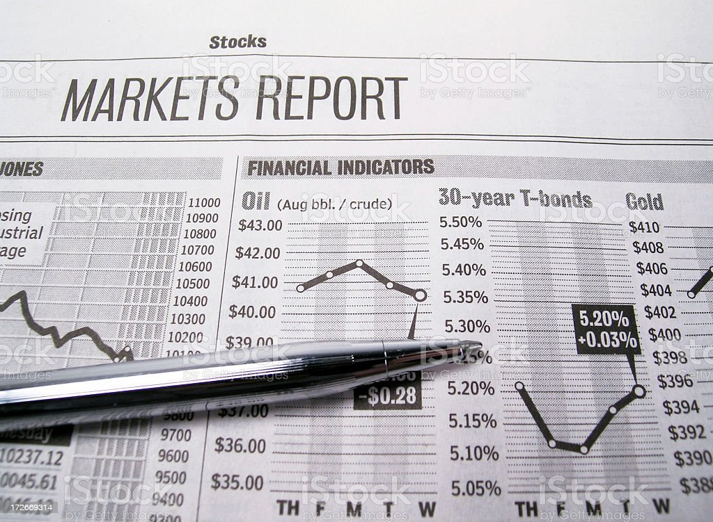 Stock market page of newspaper with pen stock photo