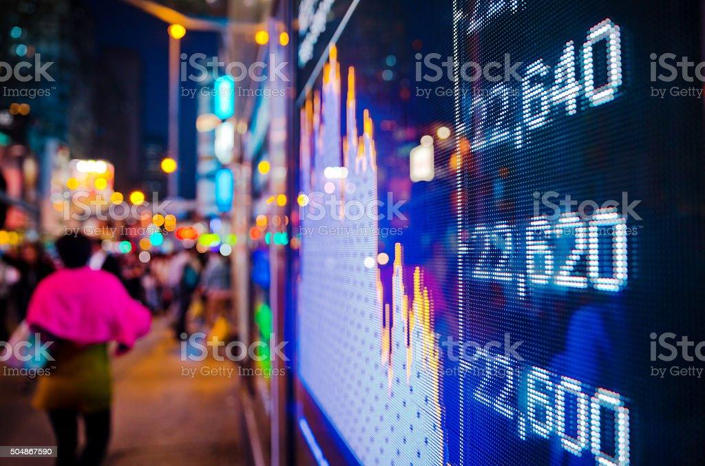 Stock market screen fading into blur stock photo