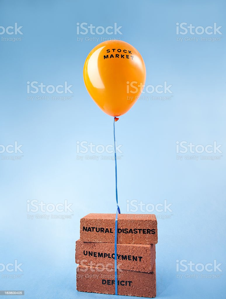 Stock market weighed down by natural disaster, unemployment and deficit stock photo