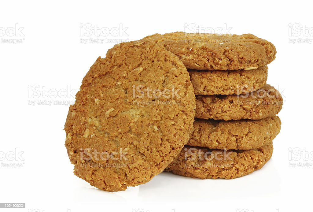Stock of Anzac biscuits on a white background stock photo