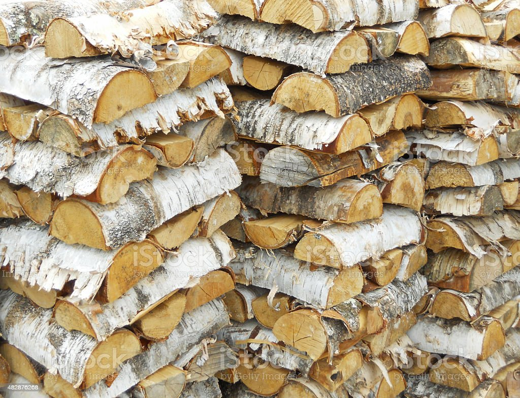 Stock of chopped birch logs stock photo