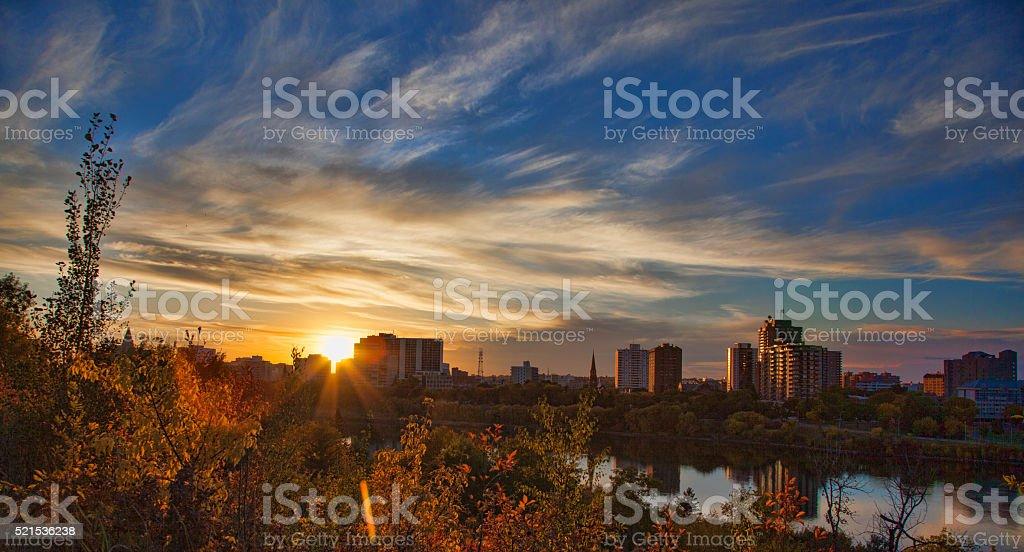 Stock Photo of Yellow Sunset over Saskatoon Skyline stock photo