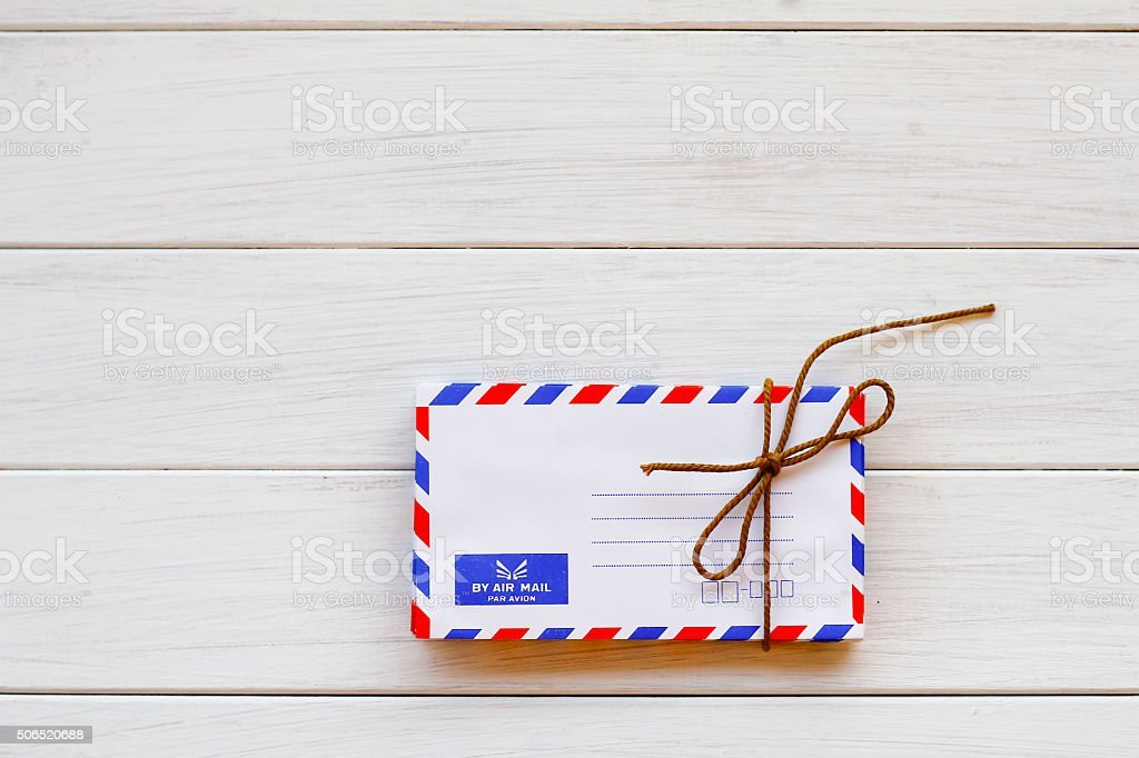 Stock Photo: Old envelope on wooden background stock photo