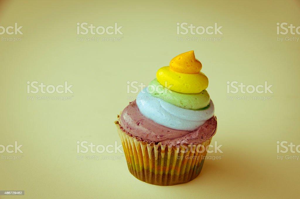Stock Photo - Rainbow cupcake on a white background stock photo