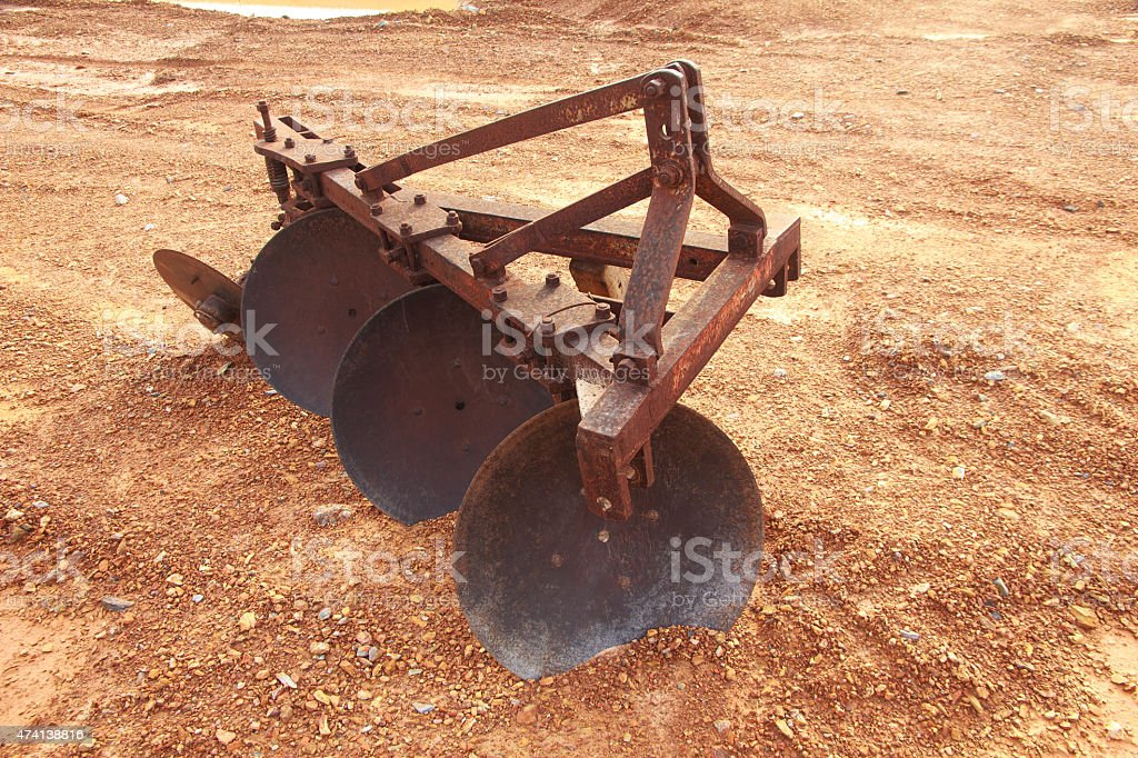 Stock Photo - shovels ancient and rusty of plow mechanical stock photo