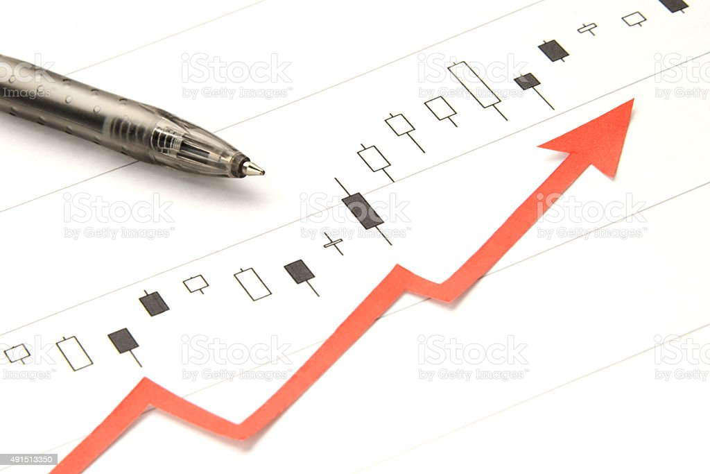 Stock price chart and up arrow stock photo