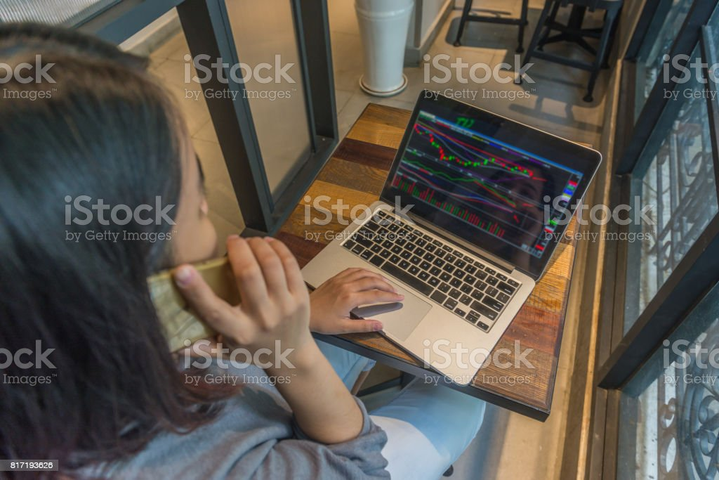 Stock Trader analyzing stock market and make a phone call stock photo