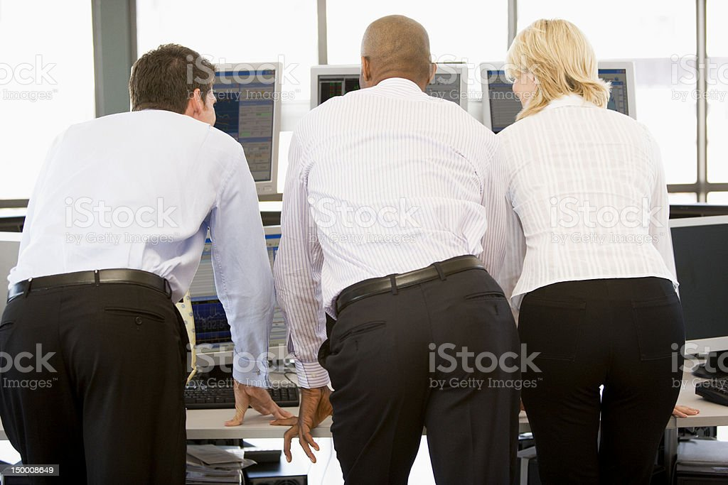Stock Traders Viewing Monitors stock photo