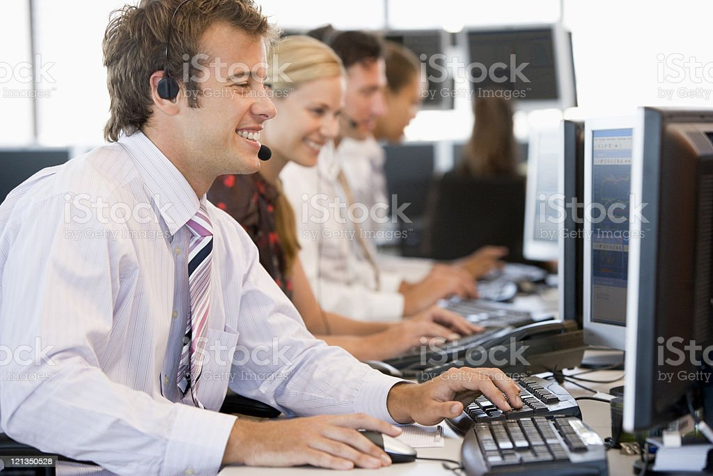Stock Traders Working At Computers stock photo