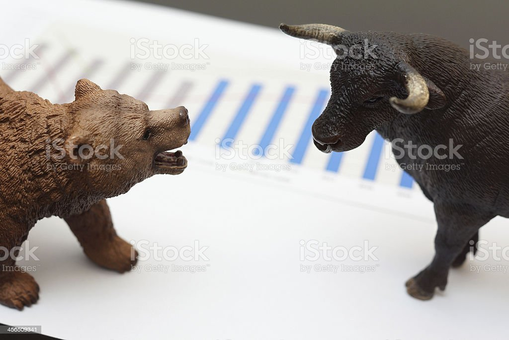 stock trading with bull and bear stock photo
