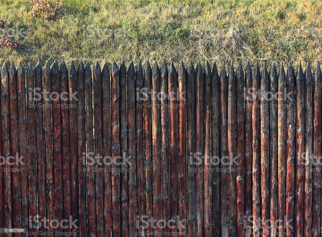 Stockade fence and grass stock photo