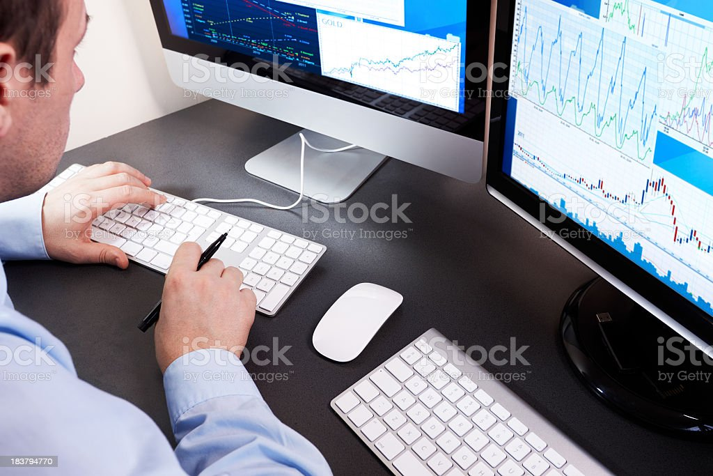 Stockbroker checks the financial results on the computer. stock photo