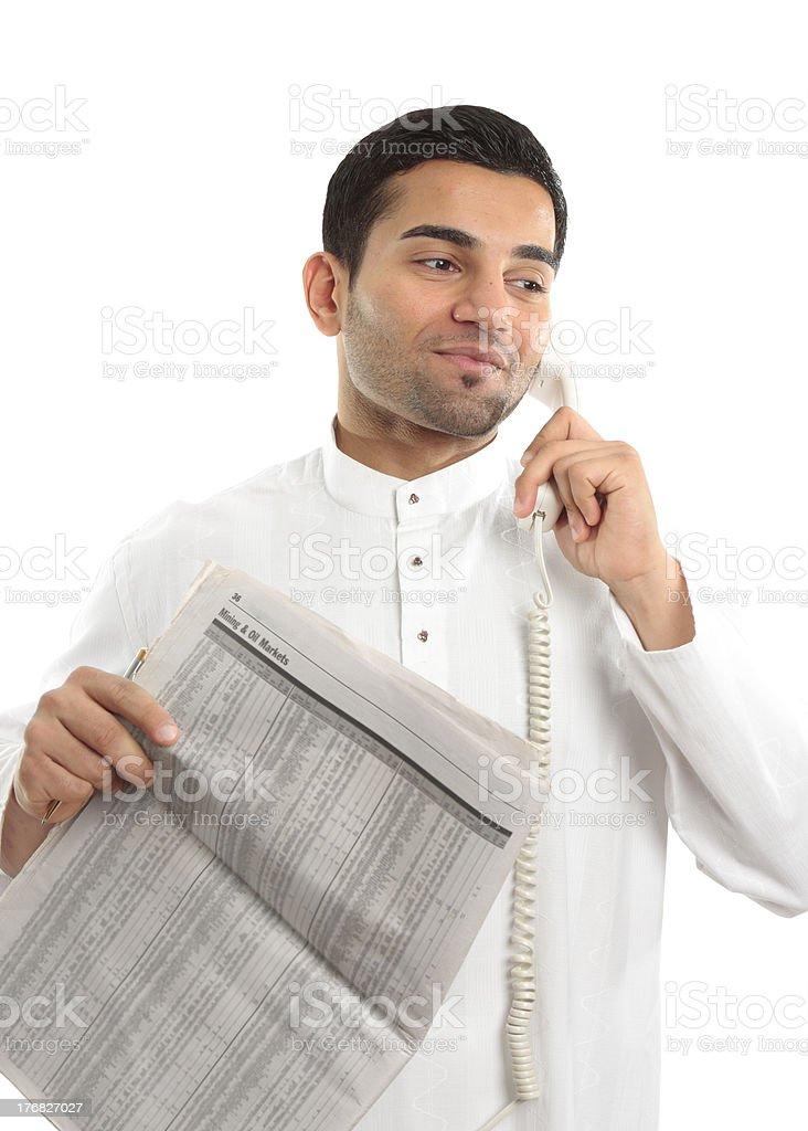 Stockbroker or Businessman on phone holding newspaper royalty-free stock photo