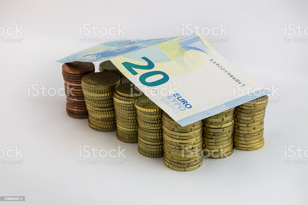 Stockes Coins and Euro Bills of 20 stock photo