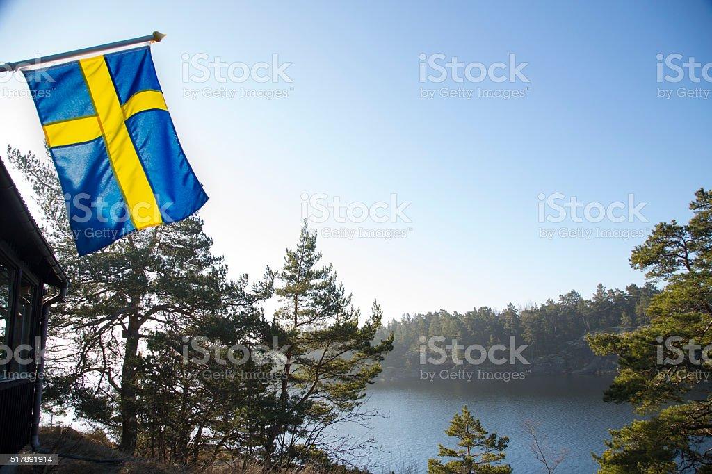 Stockholm Archipelago early spring morning, Swedish flag. stock photo