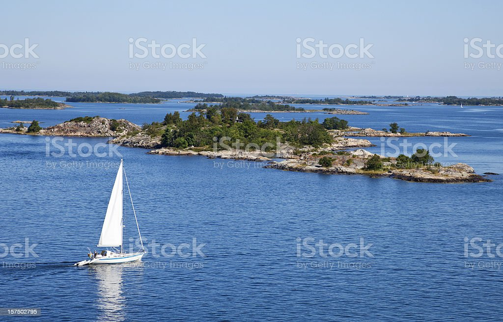 Stockholm archipelago with sailing boat and islets. stock photo