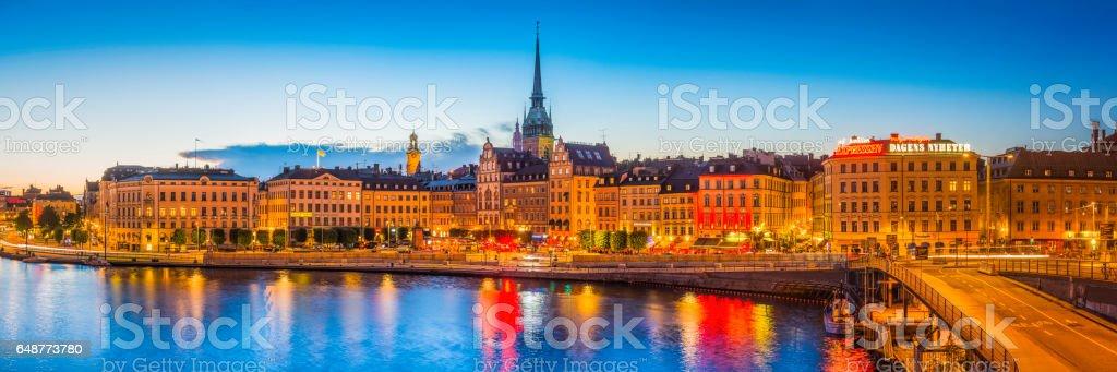 Stockholm colourful bars restaurants Gamla Stan waterfront illuminated panorama Sweden stock photo