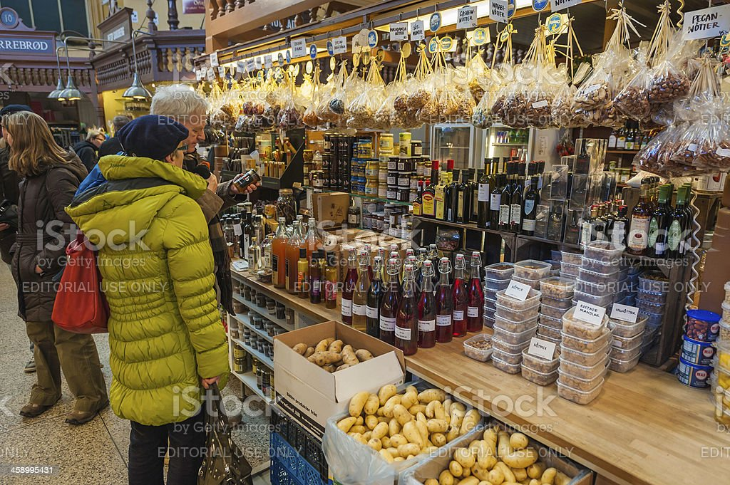 Stockholm couple shopping in Ostermalms Saluhall market Sweden royalty-free stock photo