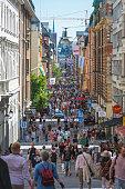 Stockholm crowds of pedestrians on Drottningaten central shopping street Sweden