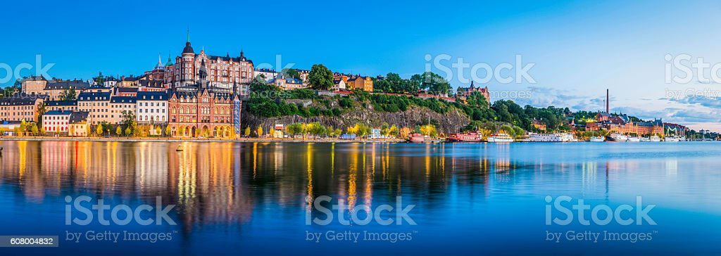 Stockholm dusk twilight illuminating Sodermalm tranquil waterfront Riddarfjarden panorama Sweden stock photo