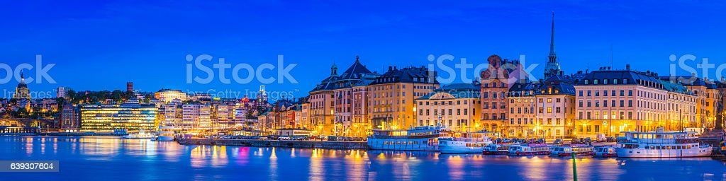 Stockholm Gamla Stan Sodermalm harbour waterfront illuminated dusk panorama Sweden stock photo