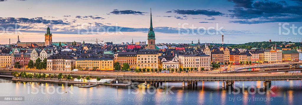 Stockholm Gamla Stan waterfront cityscape illuminated panorama at sunset Sweden stock photo