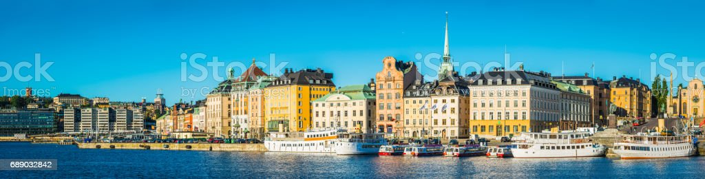 Stockholm Gamla Stan waterfront hotels and ferries sunrise panorama Sweden stock photo