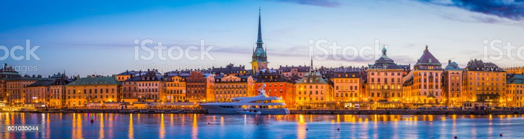 Stockholm Gamla Stan waterfront hotels spires illuminated sunset panorama Sweden stock photo