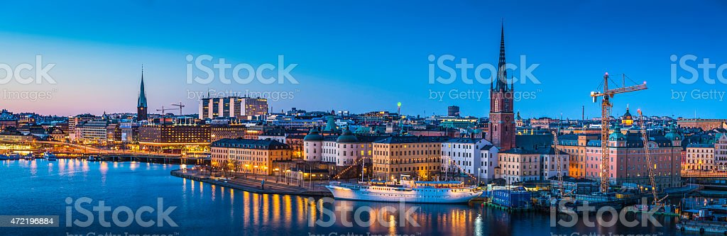 Stockholm Gamla Stan waterfront panorama illuminated at dusk Sweden stock photo