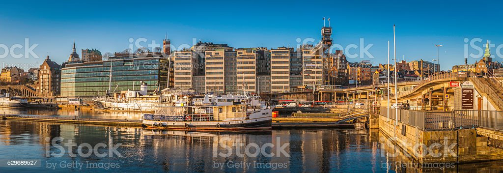 Stockholm golden sunrise sunlight on Sodermalm harbour waterfront panorama Sweden stock photo