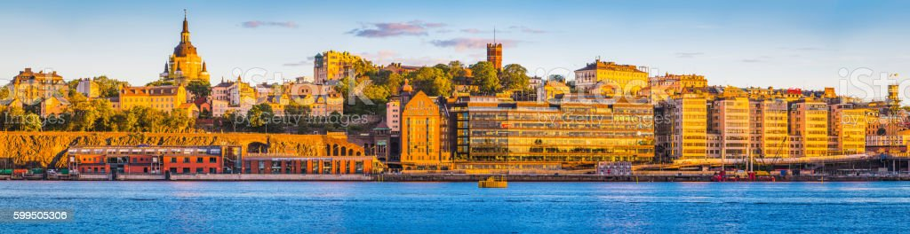 Stockholm golden sunset light on Sodermalm harbour waterfront panorama Sweden stock photo