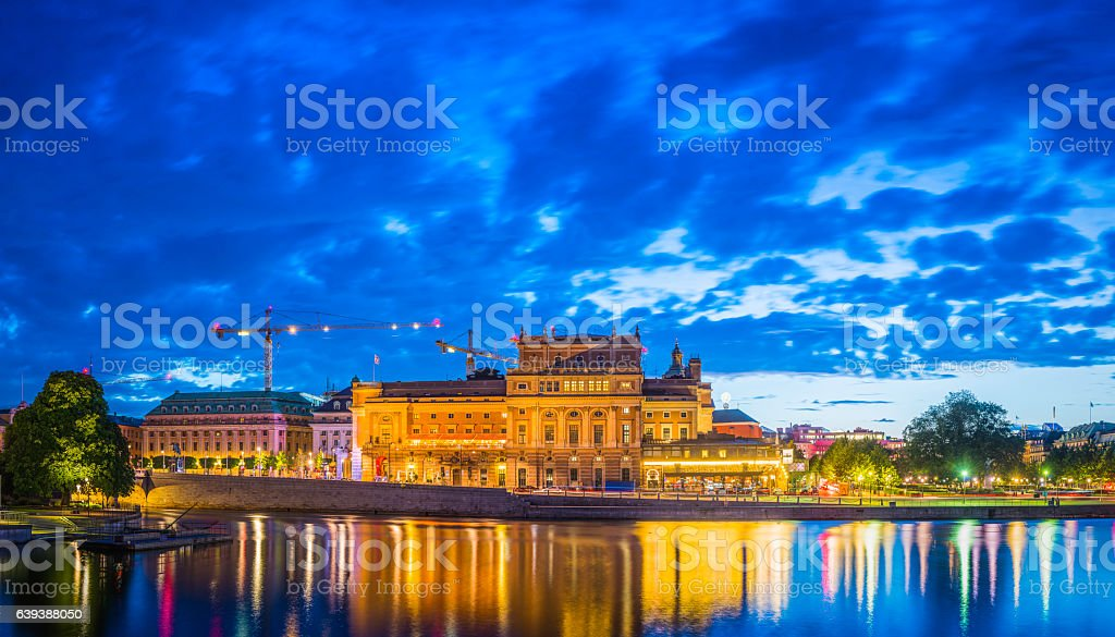 Stockholm illuminated waterfront reflecting Kungliga Operan Kunstradgarden panorama Sweden stock photo