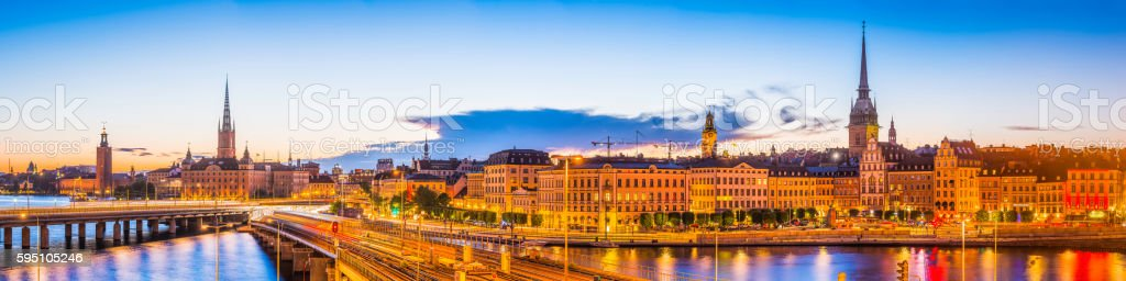 Stockholm lamplit sunset City Hall Gamla Stan spires panorama Sweden stock photo