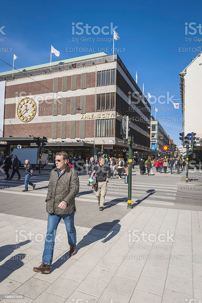 Stockholm pedestrians in downtown shopping district Sweden stock photo