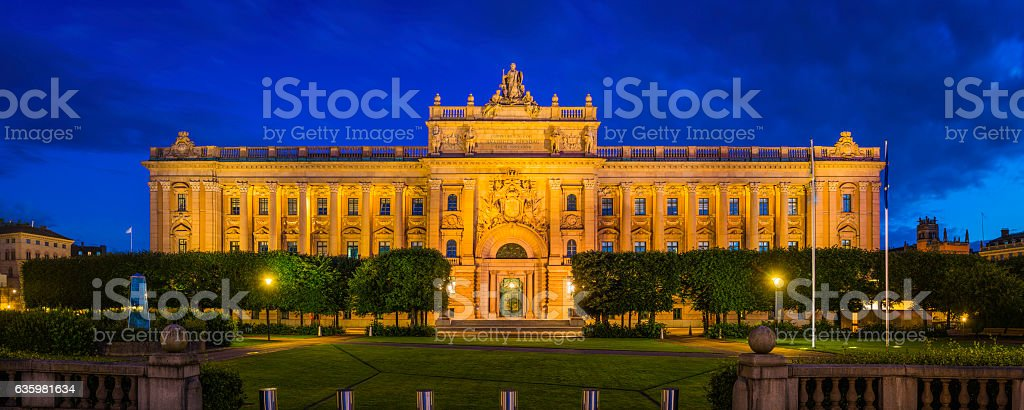 Stockholm Riksdaghuset Swedish Parliament building Riksdag illuminated at dusk Sweden stock photo
