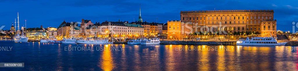 Stockholm Royal Palace ferries Gamla Stan waterfront illuminated panorama Sweden stock photo
