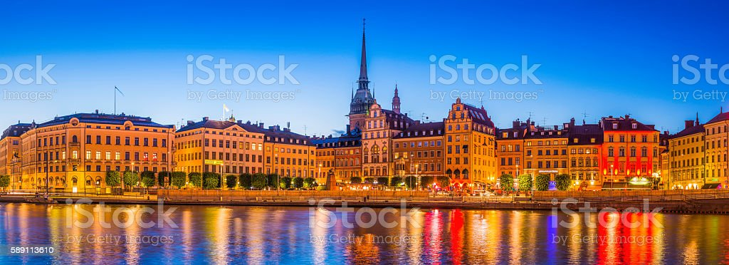 Stockholm spires and restaurants Gamla Stan illuminated dusk panorama Sweden stock photo