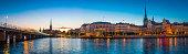 Stockholm spires and waterfront restaurants Gamla Stan illuminated sunset Sweden