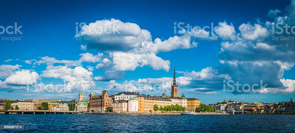 Stockholm spires blue summer skies over waterfront harbour panorama Sweden stock photo