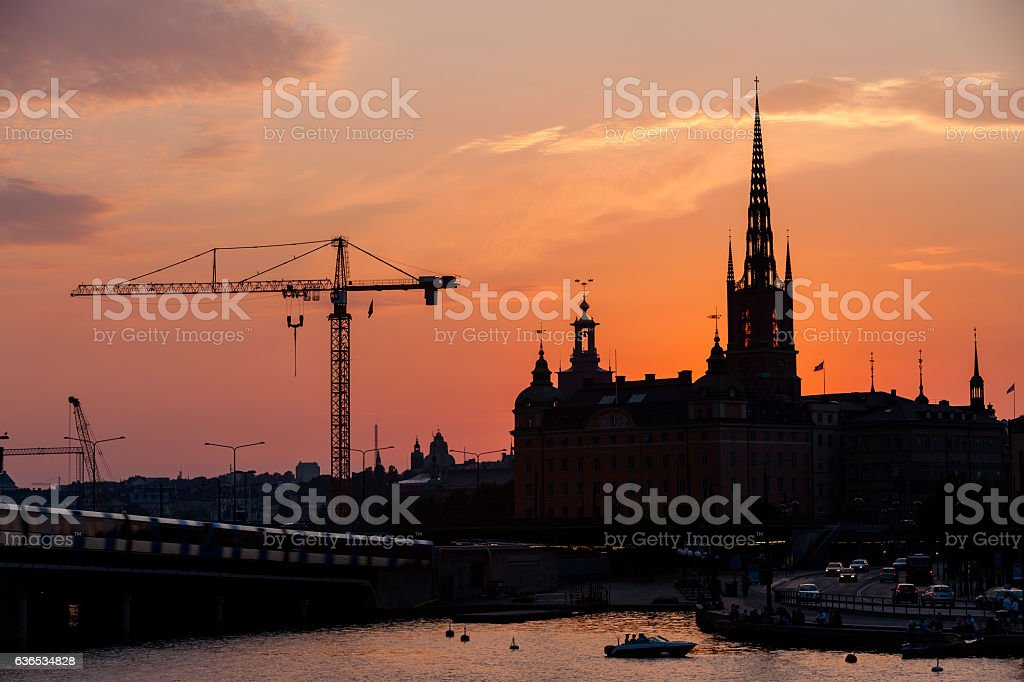 Stockholm spires & still construction cranes at sunset stock photo