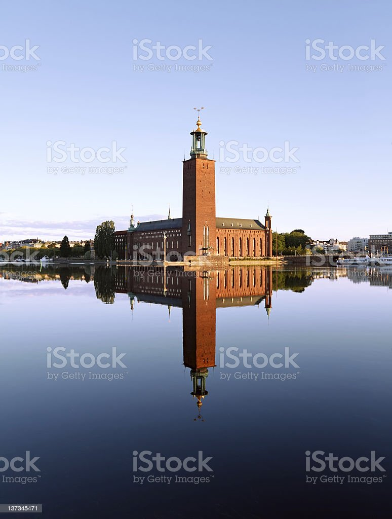 Stockholm Stadshuset with reflection on water stock photo
