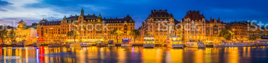 Stockholm Strandvagan harbour waterfront illuminated at dusk panorama Sweden stock photo