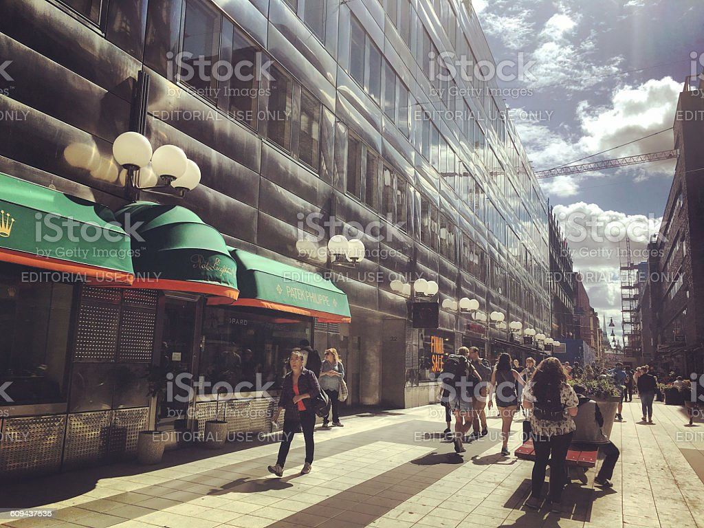 Stockholm street with shops and tourists, Sweden stock photo