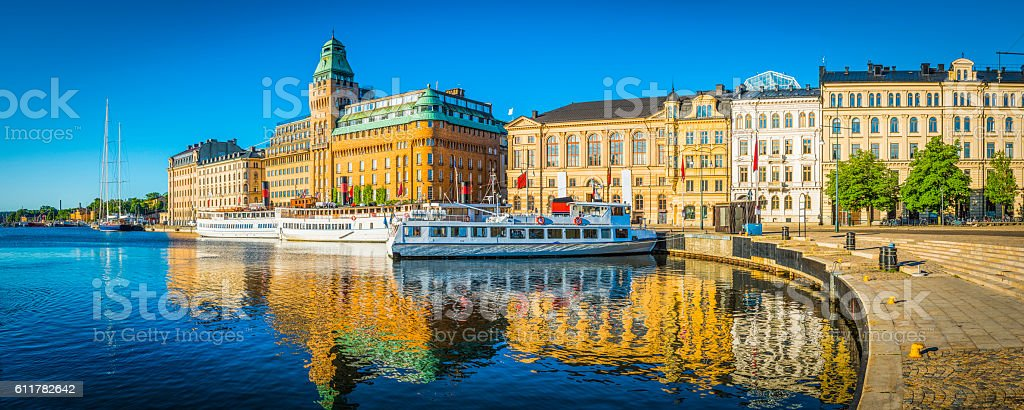 Stockholm summer sunrise on Nybroviken harbour hotels ferries panorama Sweden stock photo