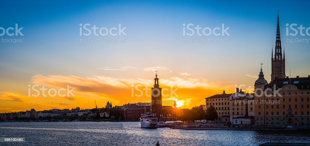 Stockholm sunset over City Hall and Gamla Stan spires Sweden stock photo