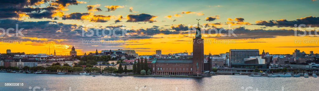 Stockholm sunset over City Hall Riddarfjarden waterfront cityscape panorama Sweden stock photo
